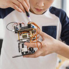 close-up-child-making-robots